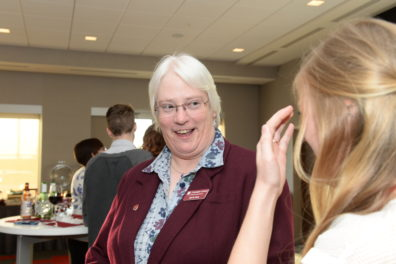 Interim Dean Lisa Gloss talks to a student