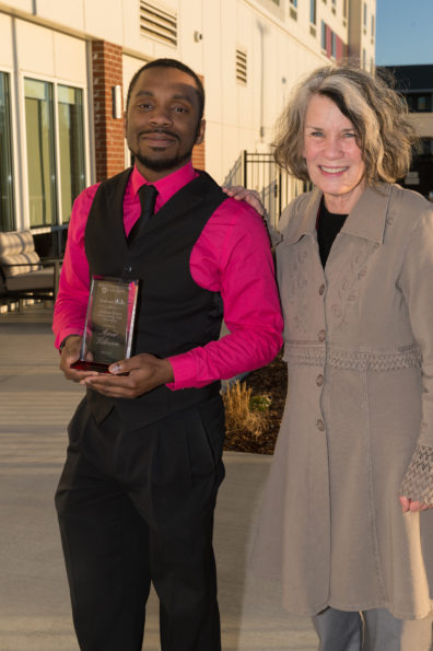 Amir Gilmore and his adviser Pamela Bettis pose with his award