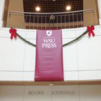 Hanging vinyl banner for WSU Press