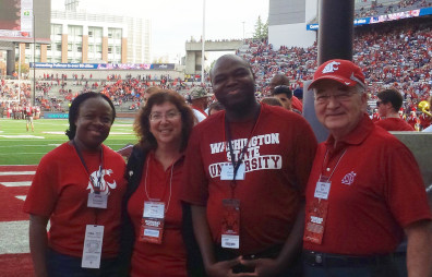 Sola Adesope was the Featured Faculty Member for WSU's victory over Oregon State. From left to right are Tolu Adesope, Erica Austin, Sola Adesope and Ron Mittlehammer.
