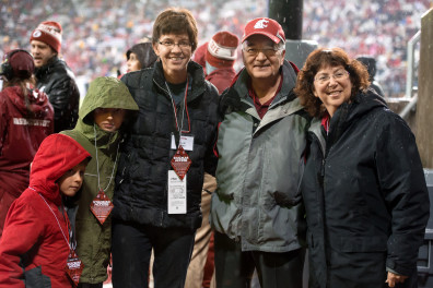 Washington State University co-Provosts Erica Austin and Ron Mittelhammer honor sociology professor Julie Kmec during a third quarter timeout of the Cougars game against the Stanford Cardinal on Saturday, Oct. 31, 2015, at Martin Stadium in Pullman.