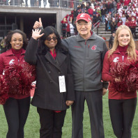 Washington State provost Ron Mittelhammer, middle right, with Featured Faculty member Jan Dasgupta, middle left, and Cougars' cheerleaders during the Cougars' 38-24 win over Arizona State on Saturday, Nov. 7 at Martin Stadium.
