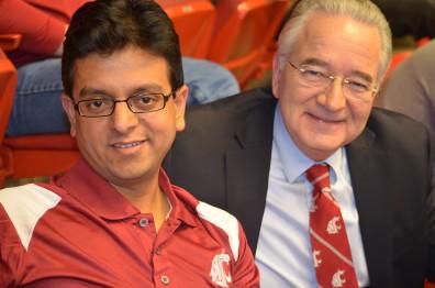 Girish Ganjyal, left, joins co-provost Ron Mittelhammer at the Cougars' basketball game on Jan. 21.