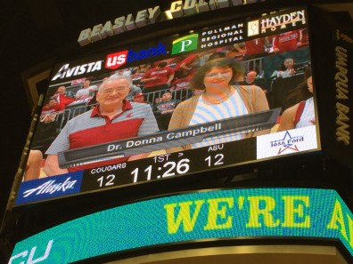 Donna Campbell and co-provost Ron Mittelhammer are shown on the video screen at Beasley Coliseum during the Cougars' game against Arizona State Saturday, Feb. 6.