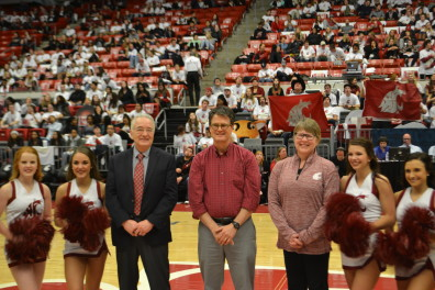 Phil Mixter, middle, was honored as the Featured Faculty member at the Feb. 18 basketball game against Stanford.