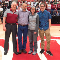 Washington State University co-Provost Ron Mittelhammer, left, honors faculty member Jeff Joireman, accompanied by his wife, Esther, and son Joshua during a first half media timeout in the Cougars' game against California Sunday, Feb. 21 at Beasley Coliseum.