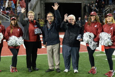 WSU faculty members Sandy Cooper, left, and Gay Selby, right, are recognized by provost Dan Bernardo, center, during the Cougars' victory over UCLA on Oct. 15 at Martin Stadium.