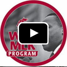 MLK program logo in background, video play button in foreground
