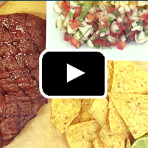 beef, corn chips, salsa in background, video play button in foreground