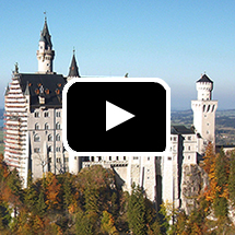European castle in background, video play button in foreground