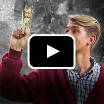 young man holds dollar bill aloft in background, video play button in foreground