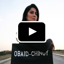 Sharmeen Obaid Chinoy in background, video play button in foreground