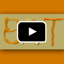 The word EAT spelled out with vegetables in background, play button in foreground