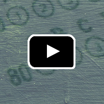 textured numbers in circles in background, play button in foreground