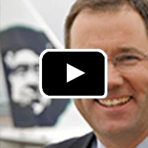 Brad Tilden and Alaska Airlines logo in background, play button in foreground.