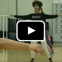 Photo: Hip hop dance class in background, play button in foreground.