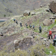 backpackers on mountainside