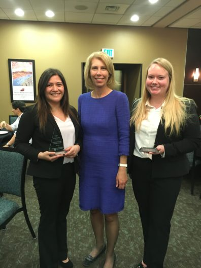 Engage student team with advisor Marie Mayes after winning WSU Business Plan Competition