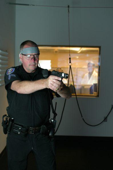 "The officer is participating in a ""use of force"" simulation."