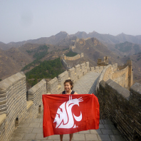 Faculty-led Business in China Melissa Ang holding the Cougar flag on the Great Wall of China. Photo submitted by Melissa Ang.