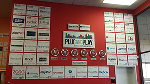 "Students toured PlugandPlay Incubator and observed the ""wall of fame"" listing successful companies."