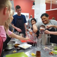 Students in Spain study abroad class preparing sangria.