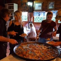 Study abroad students in Spain enjoy the completed paella they cooked as a group.