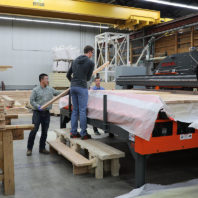 Researchers processing Cross Laminated Timber