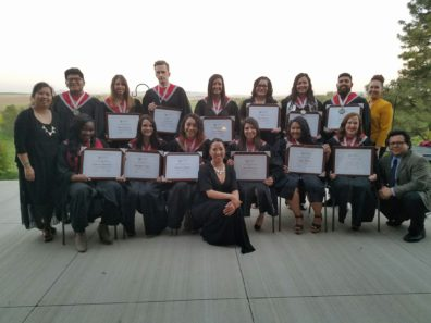 Graduating Scholars posing with their degrees