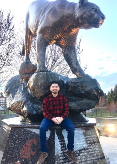 Image of Yoni Rodriquez in front of WSU Cougar statue