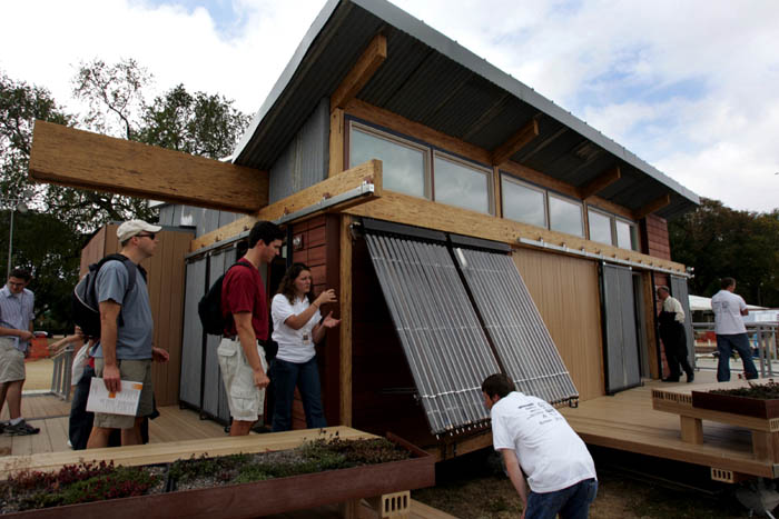 Washington State University team members show off their evacuated-tube collectors for the home's solar hot water system. The students are participating in the Department of Energy's Solar Decathlon on the National Mall. Photo by Stefano Paltera /Solar Decathlon