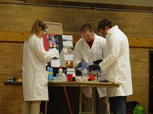 The WSU Chemical Engineering Car team make last minute adjustments to their car at the regional competition