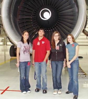 WSU engineering and business students pose in front of a plane turbine at Boeing