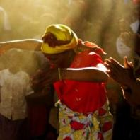 An East African woman performs a dance