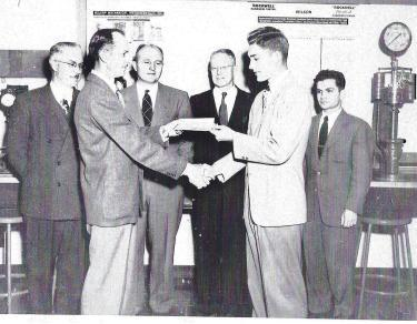 Ronald Nelson receiving scholarship check.