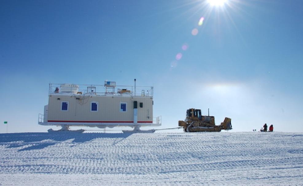 Professor Von P. Walden and team moving research equipment in Greenland