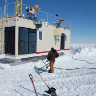 Professor Von P. Walden and his team moving the research station that is set up in Greenland to characterize atmosphere and clouds