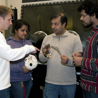 Amit Bandyopadhyay (third from left) talking with students.
