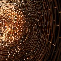 Light shines through gaps on the interior of WSU Professor Taiji Miyasaka's piece, Night Blooming.
