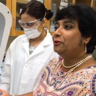 Susmita Bose in a lab discussing her research.