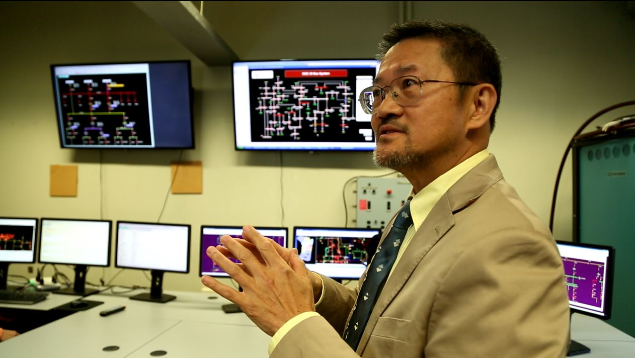 Chen-Ching Liu talking near multiple monitors displaying data.
