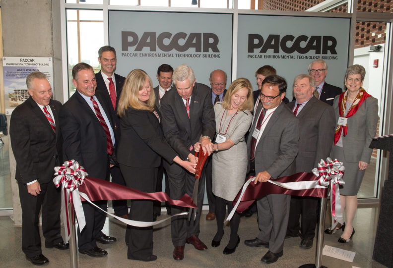 Center, Voiland College Dean Candis Claiborn, Mark Pigott, Executive Chairman of PACCAR Inc, WSU Board of Regents Chair, Ryan Durkan, and WSU Interim President Dan Bernardo cut the ribbon for PACCAR Environmental Technology Building dedication as WSU Board of Regents looks on.