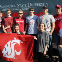 Ten members of the Mars Rover Team pose with the WSU flag.