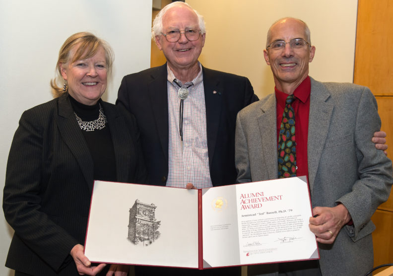 Ted Russell (center) receives award with Candis Claiborn, dean of the WSU Voiland College of Engineering and Architecture, and nominator Roger McClellan.