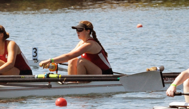 Paige Danielson sitting in the bow seat position in the WSU Varsity IV boat.