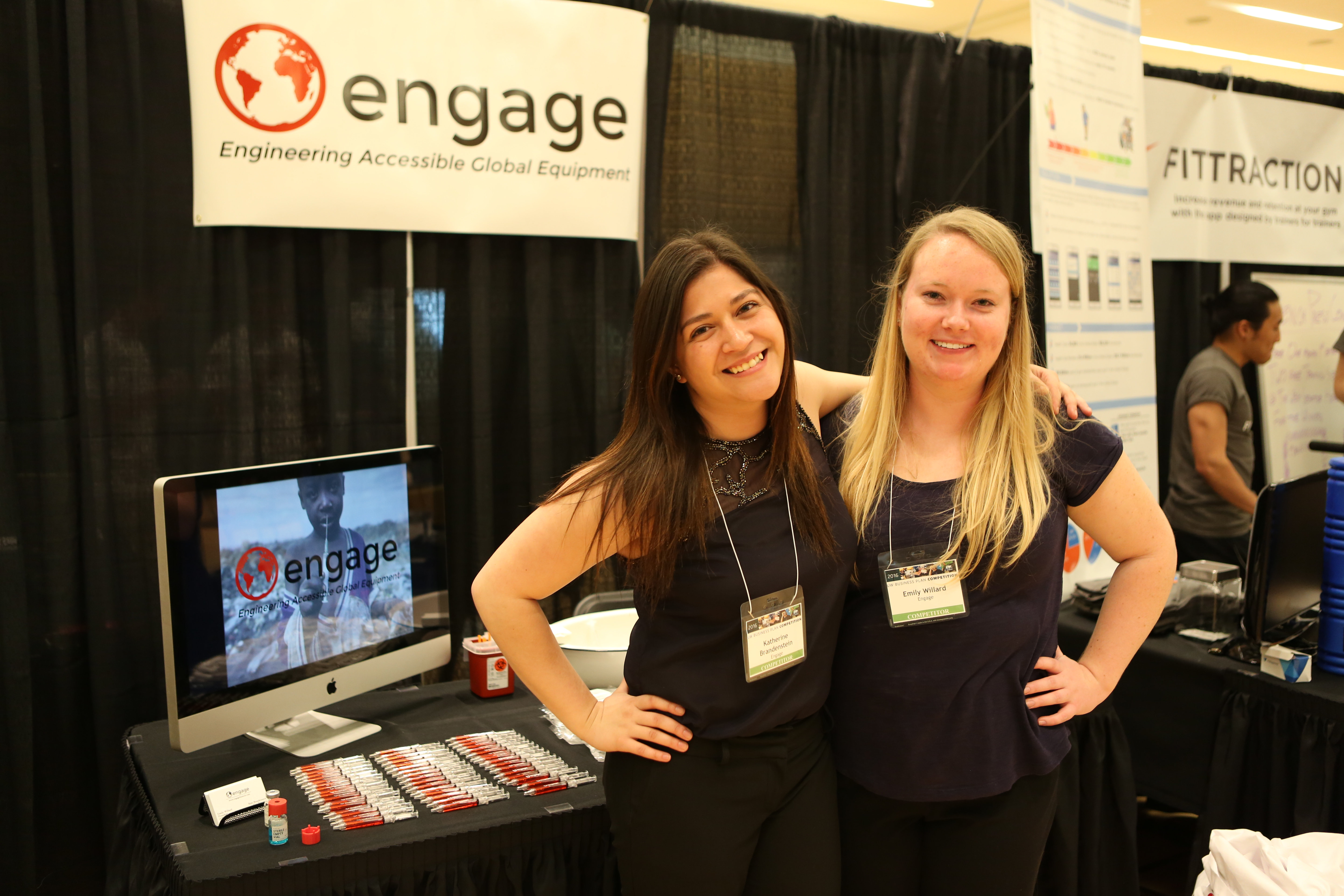 Emily Willard and Katherine Brandenstein pose in front of their competition display.