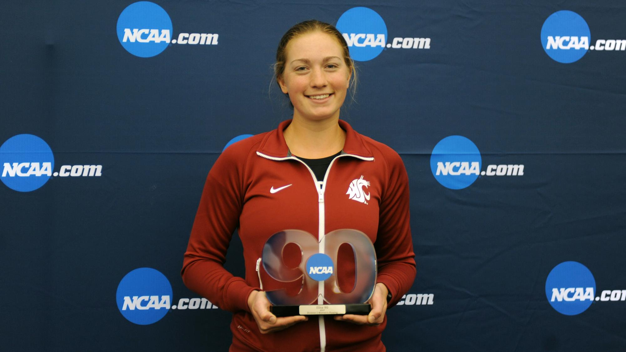 Danielson posing with her NCAA award.