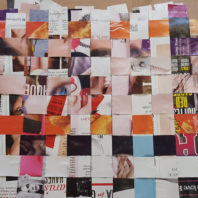 Strips cut from magazine pages are woven to create a wall.