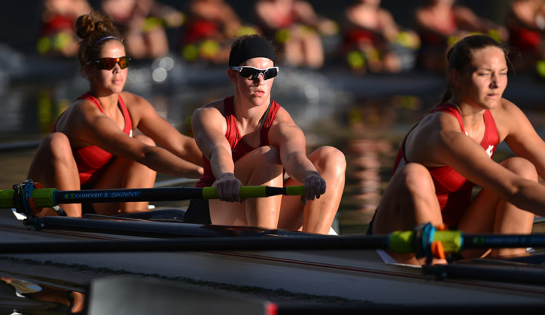 Jessica Howe rows a boat with her teammates.