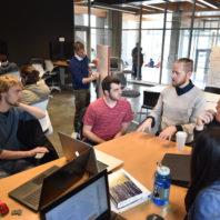 Professor Darrin Griechen works with students on solar decathlon design.